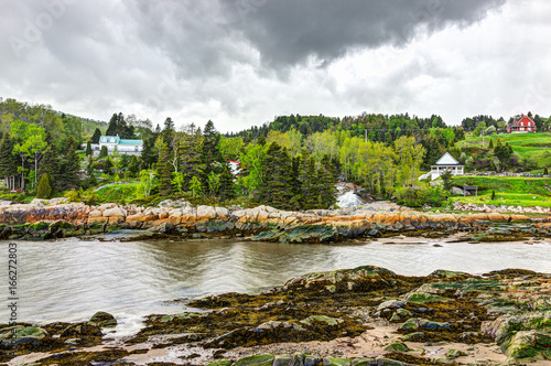 Port-au-Persil cityscape in Quebec, Canada Charlevoix region during stormy rainy day with Saint Lawrence river