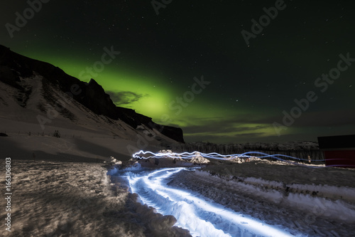 Foto op Canvas Cappuccino Aurora Borealis in with light effects, in winter