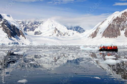 Fotobehang Antarctica Inflatable boat full of tourists, watching for whales and seals, Antarctic Peninsula, Antarctica