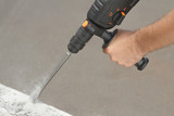 Drill beats concrete with pieces of dust and stone - 166347083