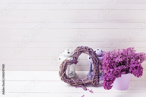 Fresh splendid lilac flowers, heart and lanterns with candles