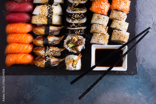 Japanese sushi big set with two wooden black chopsticks, top view