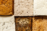 Background of different klinds of tofu blocks from above. - 166356851