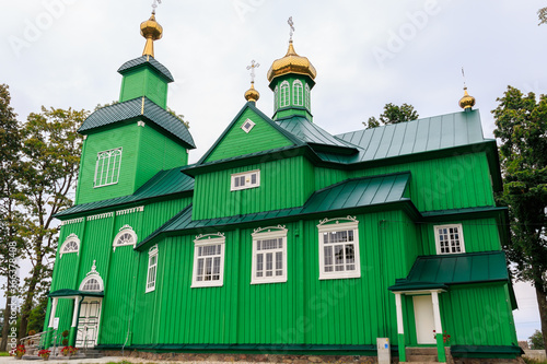 Green wooden antique building of the orthodox church of Michael the Archangel, P Poster