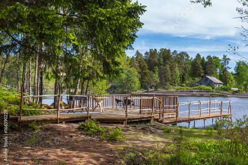Foto op Canvas Cappuccino Picnic area by the lake in Karelia