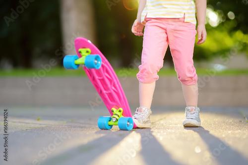 Foto op Aluminium Skateboard Closeup of skateboarder legs. Kid riding skateboard outdoor.