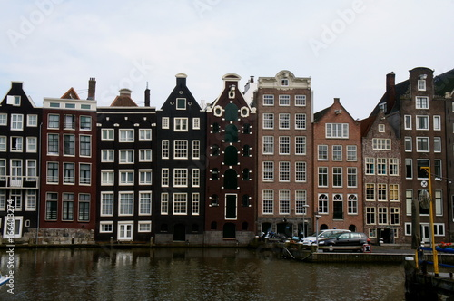 Traditional Amsterdam buildings on a canal, canal-side houses on water