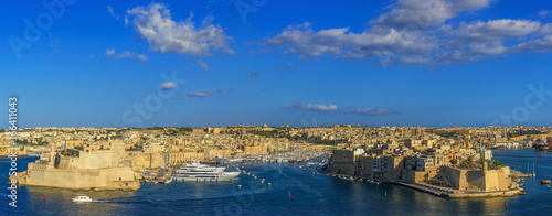 View to Grand Harbor from Upper Barrakka Gardens in Valletta at sunset, Malta