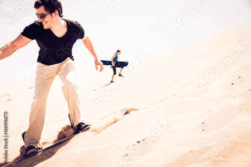 Staande foto Dubai Tourist Sandboarding In The Desert