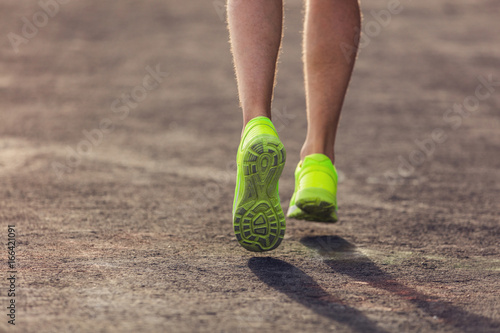 Jogging / running sneakers on the asphalt outdoors.