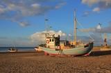 Summer day at Slettestrand, Jammerbugten. Fishing boat on the shore. - 166438457