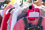 beautiful second hand girl clothes at garage sale to reuse - 166441868