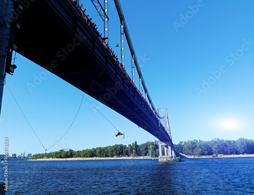 Foto op Plexiglas Kiev Ropjumping - jumping from the bridge on an elastic band to the river