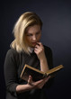 Young woman with book . - 166492203