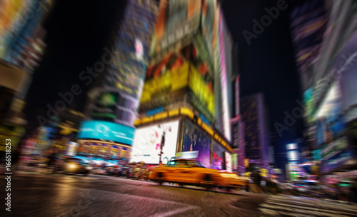 Foto op Canvas New York TAXI A yellow cab in Times Square, by night New York, USA