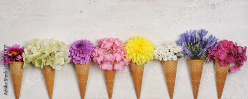 Wall mural ice cream cones with beautiful flowers