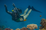 Marine aquatic background in Red sea water with freediving snorkeling model on blue background - 166561217