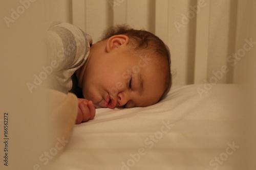 Toddler boy sleeping peacefully