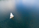White yacht on blue sea. Aerial view to sail boat. Summer activities from above. - 166563241