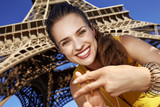 smiling woman showing hashtag gesture against Eiffel tower - 166565664