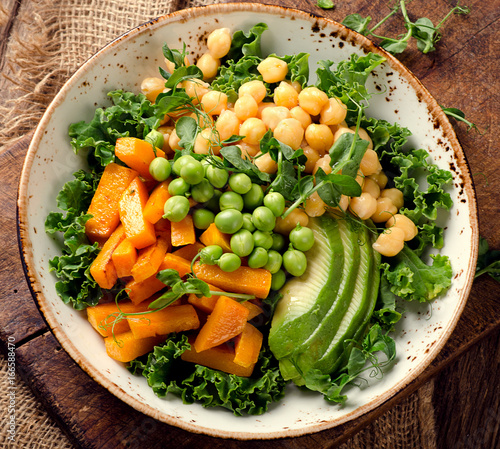 Chickpea, pumpkin and avocado vegetarian buddha bowl. - 166588470