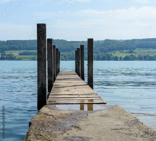 Foto op Aluminium Pier Holzsteg in den See