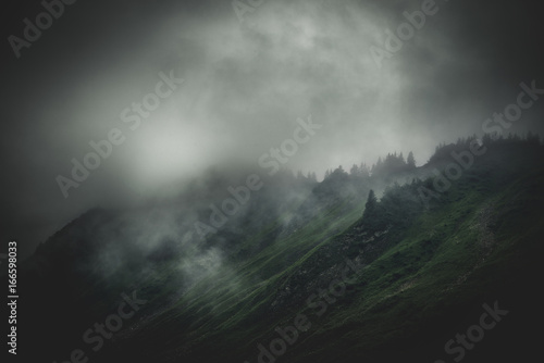Stormy, cloud shrouded mountains and terrain