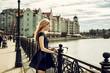 Beautiful young woman wearing fashion black dress walking in the street