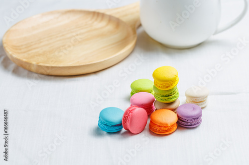 Colorful macarons cake on white background