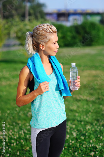 Sportive woman having rest after workout