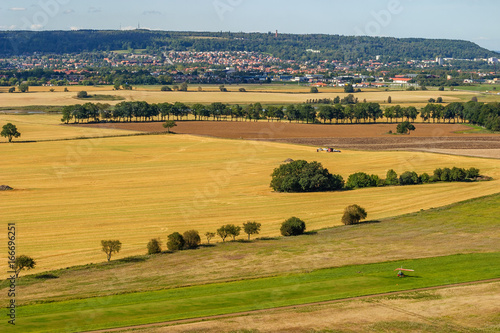 Fotobehang Landscape view with fields and a town on a mountain in Sweden