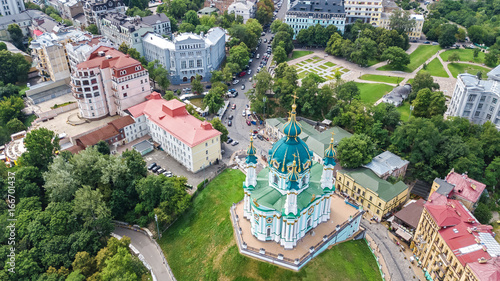 Aerial top view of Saint Andrew's church and Andreevska street from above, Podol district, city of Kiev (Kyiv), Ukraine