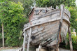 Постер, плакат: An old wooden fishing boat in garden as decoration item