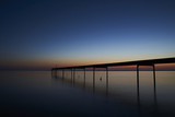 Silence and a beautiful view over the fjord from Vadum beach in Denmark at midnight - one hour after sunset            - 166702008