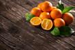 Quadro Freshly harvested orange on wooden background.