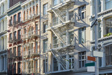 New York, cast iron architecture buildings in Soho in a sunny morning - 166725493