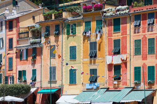 Portofino typical beautiful village with colorful buildings in Italy, Liguria in a sunny day