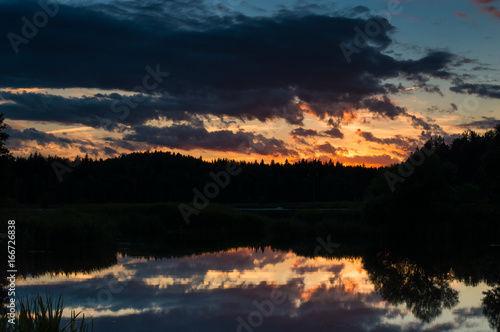 Sunset photo in clouds and reflections.