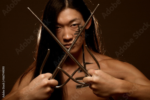 asian boy with weapons Poster