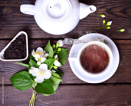 Hot black tea in a white cup and saucer