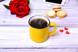 Yellow cup with hot black coffee