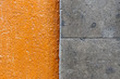 Orange and grey stone block wall texture
