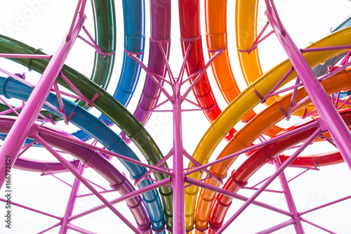 colorful water tube ride structure view against white sky
