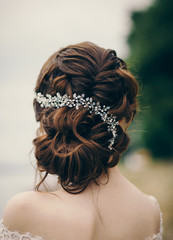 Beautiful bride with fashion wedding hairstyle outdoor