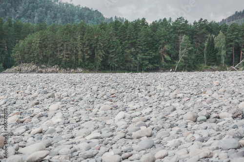 Poster Khaki Beautiful stone bank of a mountain river on the Altai