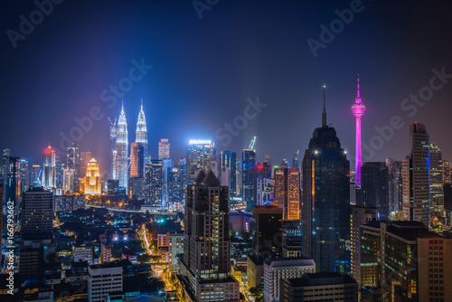 Cityscape of Kuala lumpur city skyline at night in Malaysia. Poster