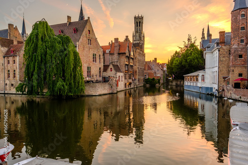 Foto op Plexiglas Brugge Bruges (Brugge) cityscape with water canal at sunset