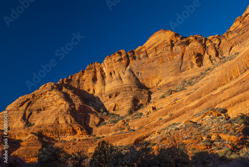 Foto op Canvas Nachtblauw Layered Red Sandstone at Sunset