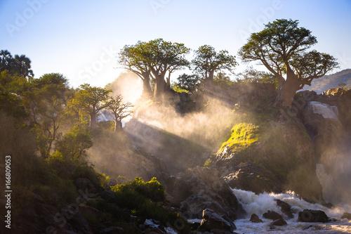 Fotobehang Baobab Misty sunrise on Epupa falls - Kunene river - Namibia - Angola border
