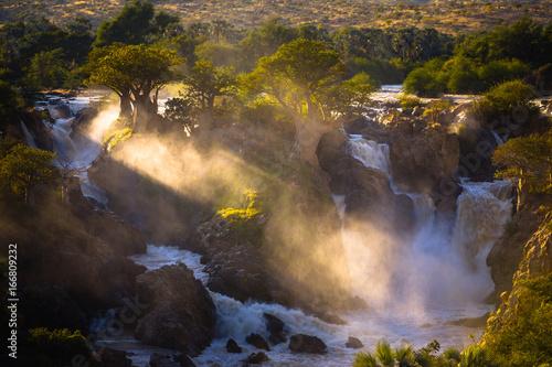 Foto Spatwand Baobab Misty sunrise on Epupa falls - Kunene river - Namibia - Angola border